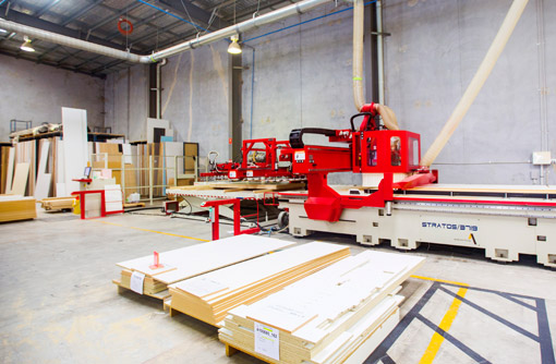 Cu to size cabinetry in a factory warehouse